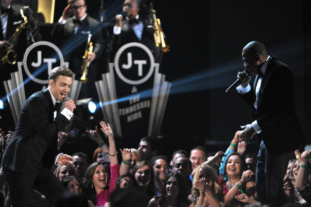 FILE - Ina Feb. 10, 2013 file photo Justin Timberlake, left, and Jay-Z perform on stage at the 55th annual Grammy Awards in Los Angeles. The Recording Academy and CBS announced Monday May 13, 2013, the 2014 Grammys will be held on Jan. 26, 2014 and the 2015 Grammys will be held on Feb. 8, 2015.(AP Photo by John Shearer/Invision/file)
