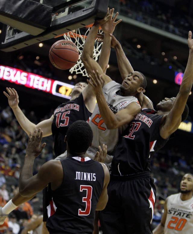 Oklahoma State's Markel Brown (22) fights for a rebound with Texas Tech's DeShon Minnis (3), Robert Lewandowski (15) and Jordan Tolbert (32) during the Big 12 tournament men's basketball game between the Oklahoma State Cowboys and the Texas Tech Red Raiders at the Sprint Center, Wednesday, March, 7, 2012. Photo by Sarah Phipps, The Oklahoman