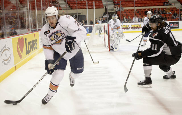 Ryan O&#039;Marra of the Oklahoma CIty Barons goes around Ryan Hollweg of the San Antonio Rampage during an AHL hockey game at the Cox Convention Center in Oklahoma City, Tuesday, Nov. 9, 2010.  Photo by Bryan Terry, The Oklahoman 