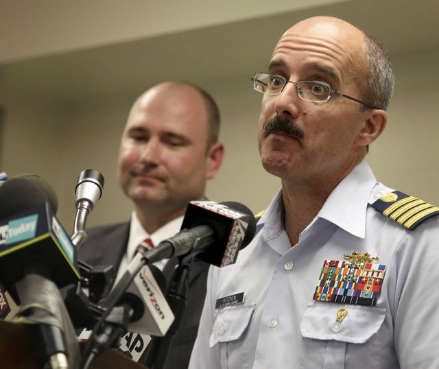 Deputy Commander of Coast Guard Sector New York Capt. Gregory Hitchen, right, and Special Agent Michael Donnelly of the Coast Guard Investigative Service take questions from the media at a news conference in New York, Wednesday, June 20, 2012. Similarities in a caller's voice and phrasings have led the Coast Guard to believe there's a link between a hoax distress call reporting a yacht explosion off New Jersey and a mayday call in Texas last month. (AP Photo/Seth Wenig)