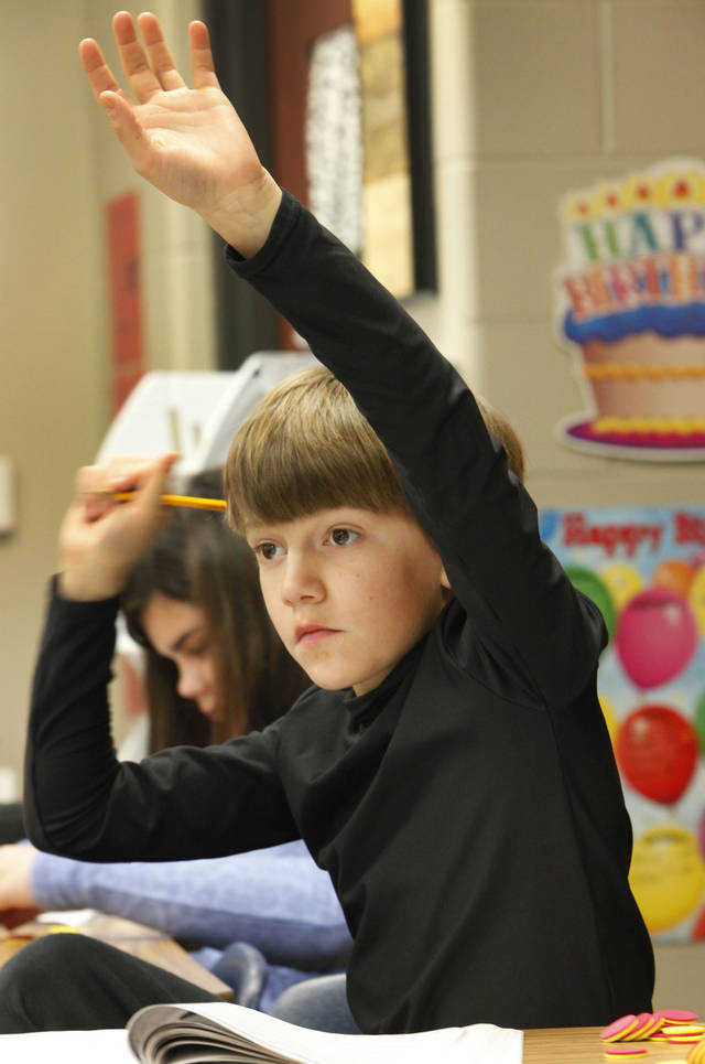 Fifth grader Price Smith raises his hand to ask a question at Centennial Elementary School in Edmond.  Photo By David McDaniel/The Oklahoman <strong>David McDaniel - The Oklahoman</strong>