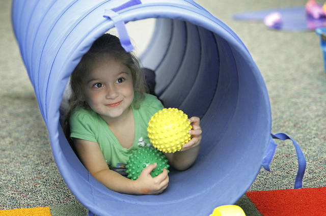 Aureli Conklin, 3, plays in a tunnel during toddlers' story and craft time activities at the Bethany Library, Thursday, May 6, 2010.       Photo by David McDaniel, The Oklahoman