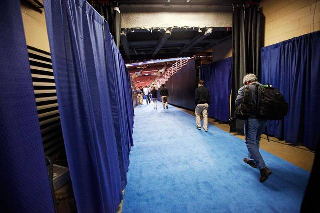 The blue carpet leads to the light at the end of the tunnel, where the basketball games get played.