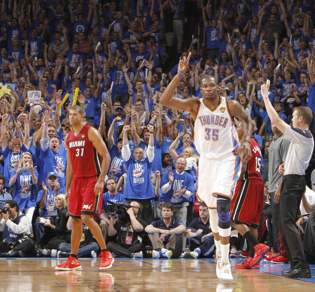 Oklahoma City's Kevin Durant (35) reacts in front of Miami's Shane Battier after making a three point shot during Game 1 of the NBA Finals between the Oklahoma City Thunder and the Miami Heat at Chesapeake Energy Arena in Oklahoma City, Tuesday, June 12, 2012. Photo by Chris Landsberger, The Oklahoman