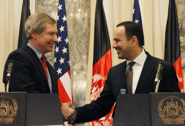 Eklil Hakimi, right, Afghanistan's ambassador in Washington, shakes hand with James Warlick, the U.S. deputy special representative for Afghanistan and Pakistan during a joint press conference in Kabul, Afghanistan, Thursday, Nov. 15, 2012. The United States and Afghanistan are starting negotiations on an agreement that will shape America's military presence in the country after the withdrawal of most foreign combat troops at the end of 2014. (AP Photo/Ahmad Jamshid)