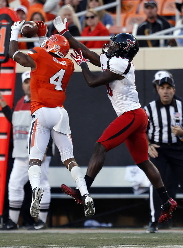 Oklahoma State&#039;s Justin Gilbert (4) breaks up a pass intended for Texas Tech&#039;s Eric Ward (18) during a college football game between Oklahoma State University and the Texas Tech University (TTU) at Boone Pickens Stadium in Stillwater, Okla., Saturday, Nov. 17, 2012. Photo by Sarah Phipps, The Oklahoman