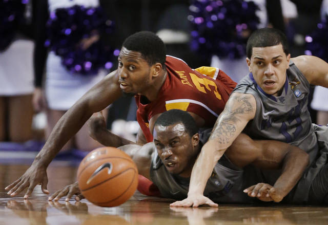 Iowa State forward Melvin Ejim (3), and Kansas State guards Martavious Irving, middle, and Angel Rodriguez (13) dive for the ball during the second half of an NCAA college basketball game in Manhattan, Kan., Saturday, Feb. 9, 2013. Kansas State defeated Iowa State 79-70. (AP Photo/Orlin Wagner)