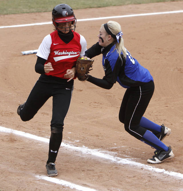 Washington's Cierra Logan is tagged out along the first base line by Little Axe's Kenzie Self during the class 3A Girl's State Softball playoffs at the ASA Hall of Fame Stadium in Oklahoma City, OK, Friday, October 5, 2012,  By Paul Hellstern, The Oklahoman