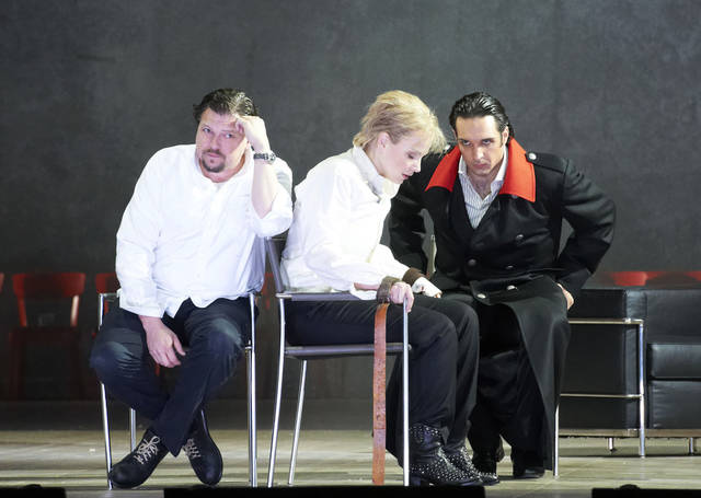 "In this photo taken Monday, May 7, 2012, Michael Schade in the role of Tito, Elina Garanca as Sesto and Adam Plachetka as Publio, from left, perform during a dress rehearsal for the opera ""La Clemenza di Tito"" by Wolfgang Amadeus Mozart at the State Opera in Vienna, Austria. (AP Photo/Wiener Staatsoper/Michael Poehn)"