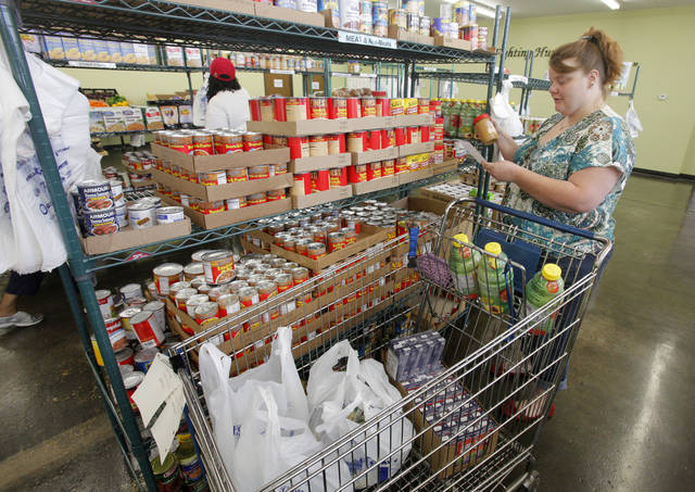 Jamie Pemberton, of Oklahoma City, shops in the canned meat section at the Food Resource Center, 3737 N Portland. Photo by Paul B. Southerland, The Oklahoman <strong>PAUL B. SOUTHERLAND - PAUL B. SOUTHERLAND</strong>