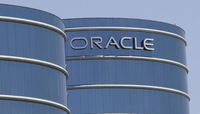 FILE-This Monday, June 18, 2012, file photo shows the Oracle headquarters in Redwood City, Calif. Oracle's earnings matched analyst estimates in the latest quarter, but a revenue decline signaled the business software maker is having a tougher time closing deals. The fiscal first-quarter results announced Thursday, Sept. 20, 2012, are the latest indication that companies and government agencies are clamping down on technology spending amid mounting uncertainty about the economy. (AP Photo/Paul Sakuma, File)