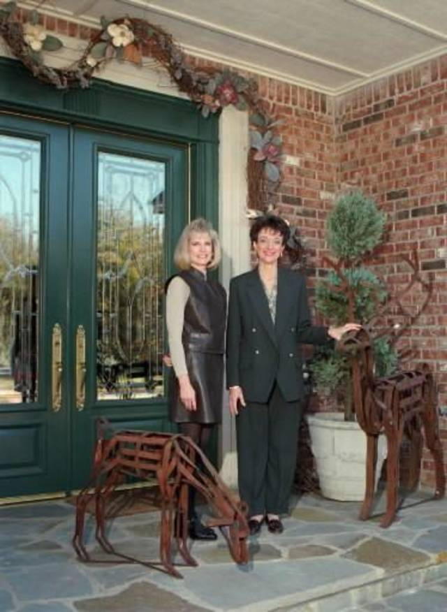 "1995 file photo - Nancy Payne and Lisa Synar at the front door of Payne's  home at 1260 Oakdale Forest Court. This  home will be on the  Edmond Women's Club "" Holidays at  Home""  Tour. (Staff Photo by Roger Klock)"