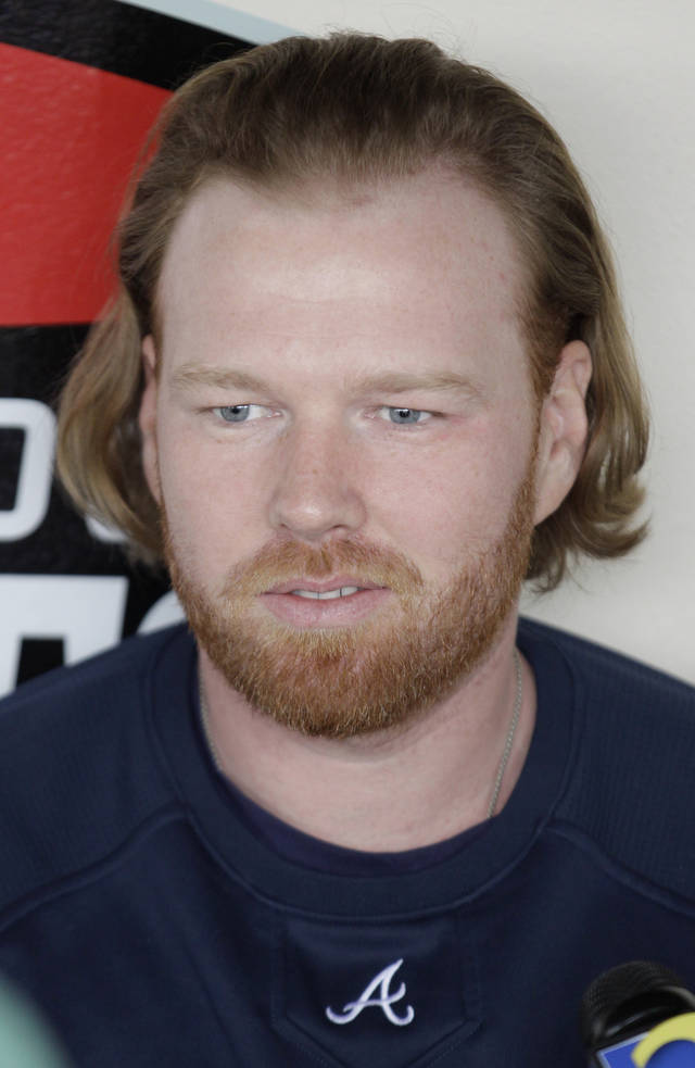 Atlanta Braves pitcher Tommy Hanson talks to the media at spring training baseball, Thursday, Feb. 23, 2012, in Lake Buena Vista, Fla. Hanson is back at camp, bruised up but feeling better after a scary single car wreck on his way to the first day of spring training. (AP Photo/Julio Cortez)