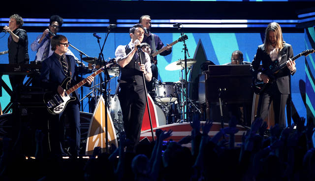 "FILE - In this Sun. Feb. 12, 2012 file photo, Adam Levine, center, and the band Maroon 5 perform during the 54th annual Grammy Awards in Los Angeles. Maroon 5's song ""Payphone (feat. Wiz Khalifa)"" top downloaded single on iTunes for the week ending May 14, 2012. (AP Photo/Matt Sayles, File)"