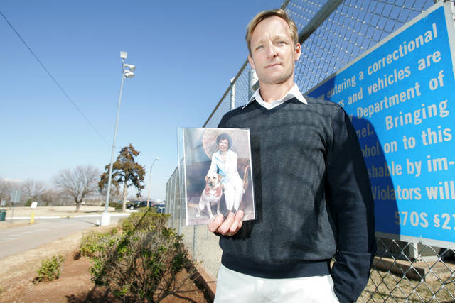 Kent Ferguson holds a photo of his aunt fallowing a parole hearing at Hillsdale Correctional Facility in Oklahoma City, Oklahoma February 10, 2009. Ferguson is oppose to the release of the woman who murdered his aunt.  BY STEVE GOOCH, THE  OKLAHOMAN.