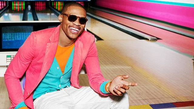 Russell Westbrook  STYLE Credits:  RALPH LAUREN BLACK LABEL pink sports jacket RALPH LAUREN BLACK LABEL orange sweater RALPH LAUREN PURPLE LABEL teal cardigan  RALPH LAUREN BLACK LABEL white jeans RALPH LAUREN BLACK LABEL slippers OMEGA gold watch WARBY PARKER tortious sunglasses   PHOTO CREDIT:  Ben Watts Grooming by Hee Soo Styling by Brian Coats