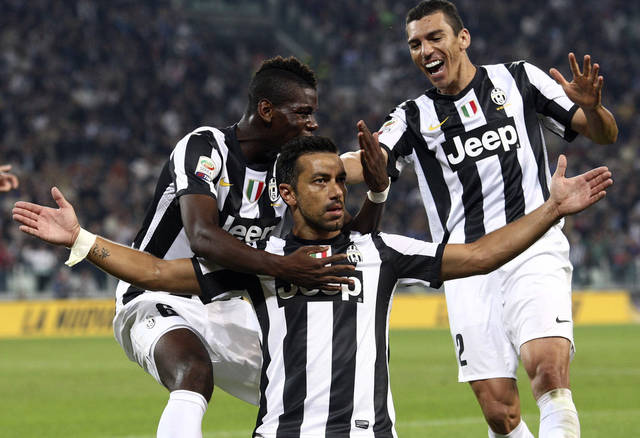 Juventus striker Fabio Quagliarella, center, celebrates with his teammates Paul Pogba, left, and Lucio after scoring, during a Serie A soccer match between Chievo Verona and Juventus, in Turin, Italy, Saturday, Sept. 22, 2012. (AP Photo/Jonathan Moscrop, Lapresse)