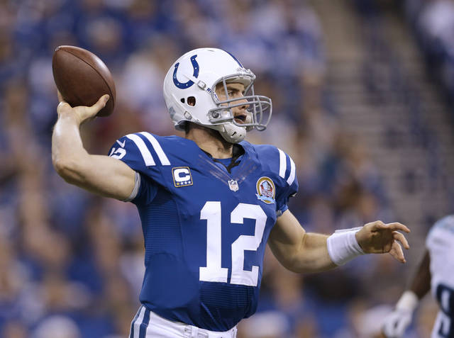 Indianapolis Colts' Andrew Luck (12) throws a pass during the first half of an NFL football game against the Tennessee Titans Sunday, Dec. 9, 2012, in Indianapolis. (AP Photo/Jeff Roberson)