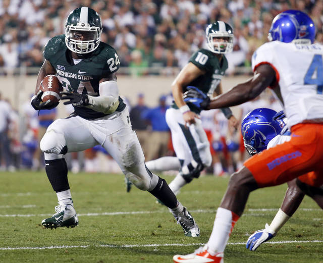 FILE - In this Aug. 31, 2012, file photo, Michigan State's Le'Veon Bell (24) gets past Boise State's Jerell Gavins (5) to score the game-winning touchdown during the fourth quarter of an NCAA college football game in East Lansing, Mich. Bell figured to have a bigger role this season in Michigan State's backfield, but his opening game last week against Boise State was a head turner. Bell had 44 carries for 210 yards in perhaps the best offensive performance by any player in the country.(AP Photo/Al Goldis, File)