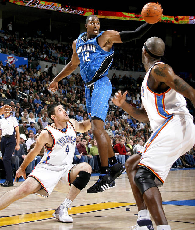 Orlando's Dwight Howard tries for a rebound between Oklahoma City's Nick Collison, left, and Joe Smith during the NBA basketball game between the Oklahoma City Thunder and the Orlando Magic at the Ford Center in Oklahoma City, Wednesday, Nov. 12, 2008. BY BRYAN TERRY, THE OKLAHOMAN
