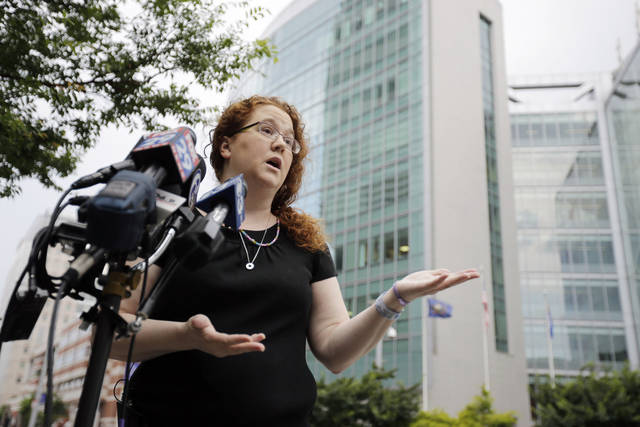 Janet Murnaghan speaks during a news conference outside Children's Hospital of Philadelphia, Friday, June 28, 2013, in Philadelphia. Murnaghan's 10-year-old daughter Sarah recently underwent a double-lung transplant amid a national debate over the organ allocation process has undergone a second transplant after the first failed and is now taking some breaths on her own, the girl's parents said Friday. (AP Photo/Matt Slocum)