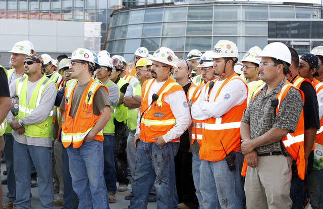 Construction workers are shown in this September 2011 photo of the Devon Energy Center toping-out ceremony. Photo by Paul B. Southerland, The Oklahoman <strong>PAUL B. SOUTHERLAND</strong>