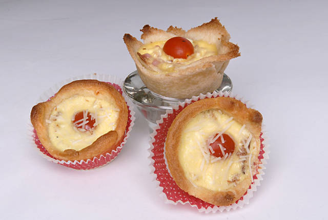 Using a pre-made bread dough, such as crescent roll dough, makes egg tarts an easier dish to make. (Joan Barnett Lee/Modesto Bee/MCT)