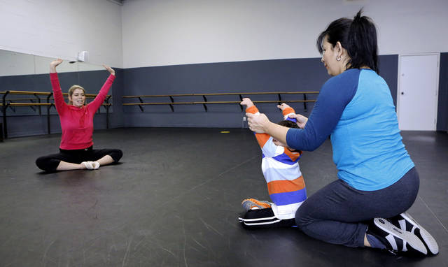 Dance instructor Katie Veenhuizen, left,  works with Oscar Riano, Jr., 4, during a weekly ballet class for young children  with Down syndrome held at the Oklahoma City Ballet, 7421 N. Classen Blvd. on  Jan. 12, 2013. Helping Oscar is his mother, Magaly Riano.     Photo by Jim Beckel, The Oklahoman