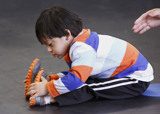 Dance instructor Katie Veenhuizen works with Oscar Riano, Jr., 4, during a weekly ballet class for young children  with Down syndrome held at the Oklahoma City Ballet, 7421 N. Classen Blvd. on  Jan. 12, 2013. Helping Oscar is his mother, Magaly Riano.     Photo by Jim Beckel, The Oklahoman