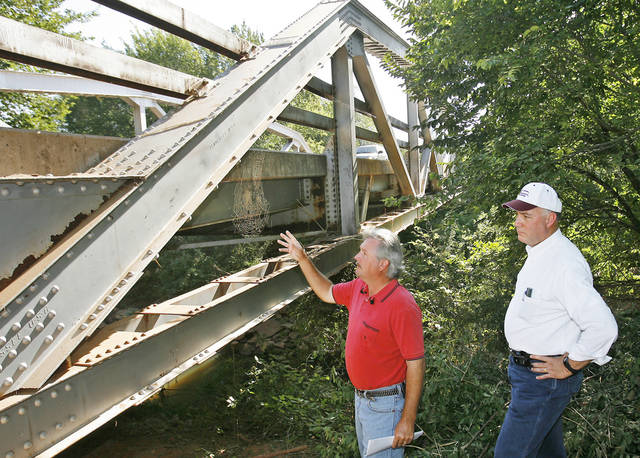 Oklahoma County Engineer Stacey Trumbo and County Commissioner Ray Vaughn inspect  a bridge on Coffee Creek Road just east of Western, Friday, August 10, 2007. The bridge is a fracture critical design like the one that collapsed in Minnesota.    BY DAVID MCDANIEL, THE OKLAHOMAN.