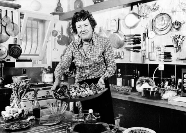 FILE- In this Aug. 21, 1978 file photo shows American television chef Julia Child showing a salade nicoise she prepared in the kitchen of her vacation home in Grasse, southern France.  More so than the tools and techniques she popularized,  Child's most lasting legacy may be her spirit and sense of humor. That was the conclusion of several chefs and food magazine editors asked to describe Child's memorable contributions to American home cooking as a new movie about her life is about to open. (AP Photo) ORG XMIT: NYLS134