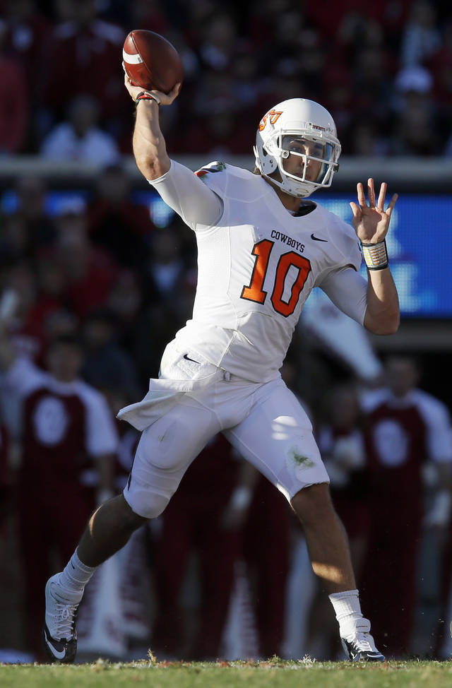 Oklahoma State's Clint Chelf (10) passes during the Bedlam college football game between the University of Oklahoma Sooners (OU) and the Oklahoma State University Cowboys (OSU) at Gaylord Family-Oklahoma Memorial Stadium in Norman, Okla., Saturday, Nov. 24, 2012. Photo by Nate Billings , The Oklahoman