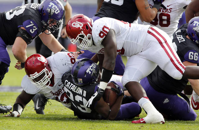 Oklahoma's Stacy McGee (92) and David King (90) bring down TCU's B.J. Catalon (23) during the college football game between the University of Oklahoma Sooners (OU) and the Texas Christian University Horned Frogs (TCU) at Amon G. Carter Stadium in Fort Worth, Texas, on Saturday, Dec. 1, 2012. Photo by Steve Sisney, The Oklahoman