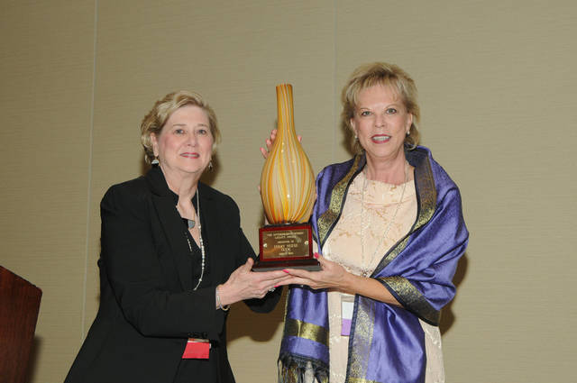 Terry Neese, right, receives the 2013 Enterprising Women Legacy Award from Enterprising Women Publisher and CEO Monica Smiley during the 11th Annual Enterprising Women of the Year Awards Celebration on April 5 in Fort Lauderdale, Fla. PHOTO PROVIDED