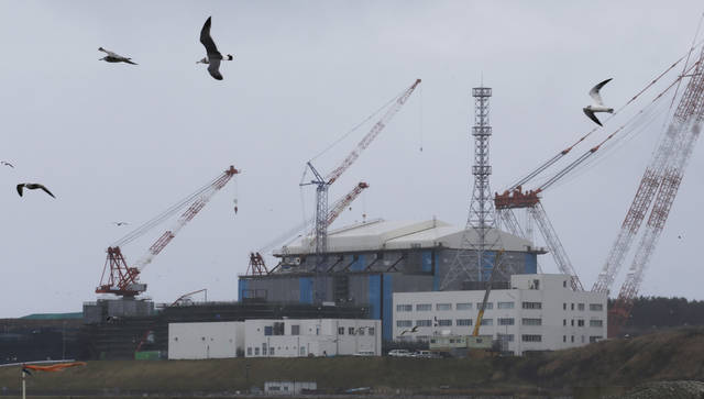 In this Nov. 9, 2012 photo, seagulls fly near the Oma nuclear power plant surrounded by cranes in Oma in Aomori, northern Japan. In nearby Oma, construction is set to resume on an advanced reactor that is not a fast-breeder but can use more plutonium than conventional reactors. Its construction, begun in 2008 for planned operation in 2014, has been suspended since the March 2011 Fukushima nuclear meltdowns, and could face further delays as Japan&#039;s new nuclear watchdog prepares new safety guidelines. (AP Photo/Koji Sasahara)