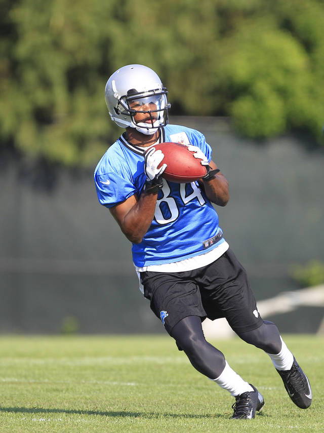 Detroit Lions receiver Ryan Broyles makes a catch during NFL football training camp in Allen Park, Mich. Monday, July 30, 2012. (AP Photo/Carlos Osorio)