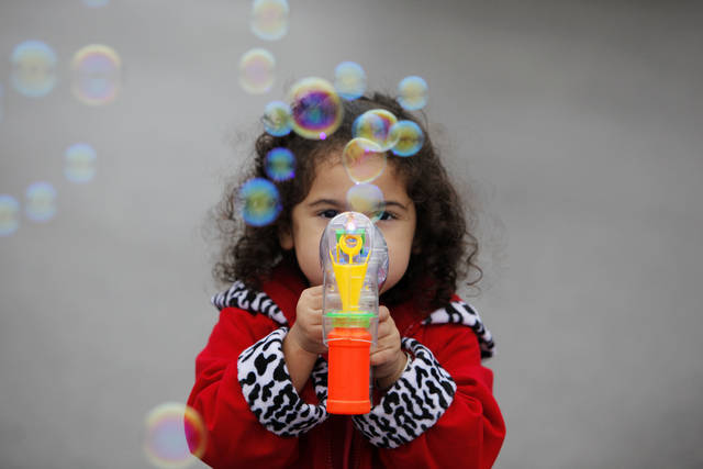 Lexie Martin, 2, of Yukon, Okla., plays with a bubble gun during the 2011 Oklahoma State Fair at State Fair Park in Oklahoma City, Friday, Sept. 16, 2011. Photo by Nate Billings, The Oklahoman