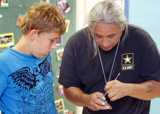 Albert Grayeagle demonstrates how to create a clay flute to ten-year-old Michael Shores during a summer camp at the Temple B'nai Israel in Oklahoma City, OK, sponsored by the Jewish Federation of Greater Oklahoma City, Tuesday, June 26, 2012,  By Paul Hellstern, The Oklahoman