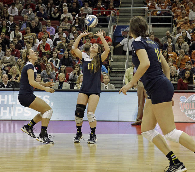 Michigan's Ally Sabol (13) sets for teammates Lexi Dannemiller, left, and Lexi Erwin,, right, against Texas during the national semifinals of the NCAA college women's volleyball tournament semifinal in Louisville, Ky., Thursday, Dec. 13, 2012.  (AP Photo/Garry Jones)