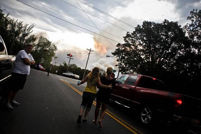 WILDFIRE: Two women walk to further inspect a large fire in Edmond on Saturday, August 6, 2011. Photo by Zach Gray ORG XMIT: KOD