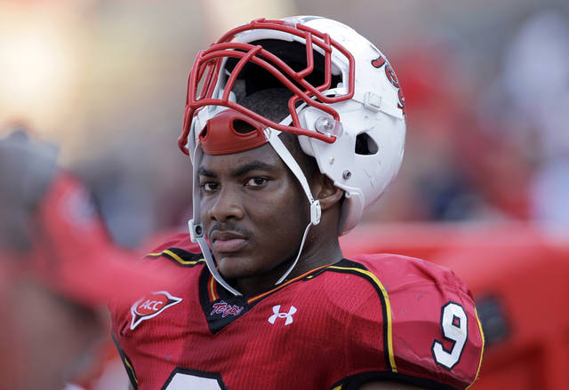 "FILE - In this Sept. 9, 2010, file photo, Maryland linebacker Demetrius Hartsfield watches from the sideline during the second half of an NCAA college football game against Florida International in College Park, Md. Hartsfield is affectionately called ""Meat"" by his coaches and teammates. To opposing quarterbacks, he's simply dangerous _ and a big reason why the Terrapins are ranked seventh in the nation in total defense. (AP Photo/Rob Carr, File)"