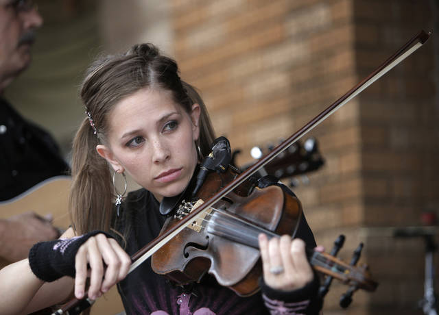 Erica James performs violin for entertainment during the Art Crawl.