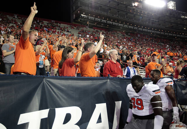 Fans cheer on Oklahoma State before the college football game between the University  of Arizona and Oklahoma State University at Arizona Stadium in Tucson, Ariz.,  Thursday, Jan. 17, 2008. Photo by Sarah Phipps, The Oklahoman