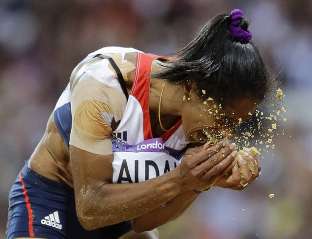 Britain's Yamile Aldama reacts during the women's triple jump final during the athletics in the Olympic Stadium at the 2012 Summer Olympics, London, Sunday, Aug. 5, 2012. (AP Photo/David J. Phillip )