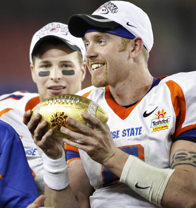 Jared Zabransky holds the golden ball from the Fiesta Bowl Trophy after the Bronchos defeated the University of Oklahoma Sooners (OU) in college football at the Tostitos Fiesta Bowl inside University of Phoenix Stadium, on Monday, Jan. 1, 2007, in Glendale, Ariz.   Boise State defeated Oklahoma 43-42 in overtime. 