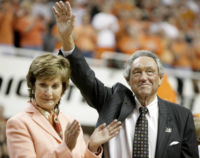 Former OSU head coach Eddie Sutton waves to the crowd as wife Patsy Sutton applauds a ceremony at halftime during the men's college basketball game between Oklahoma State University and Texas A&M at Gallagher-Iba Arena in Stillwater, Okla., Wednesday, Feb. 21, 2007. By Matt Strasen, The Oklahoman