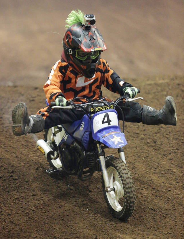 Taylor Tosh, of Amarillo, Texas, shows off during the Kicker Arenacross race at the Lazy E Arena in Guthrie, Okla., Sunday, Jan. 13, 2013.  Photo by Garett Fisbeck, For The Oklahoman