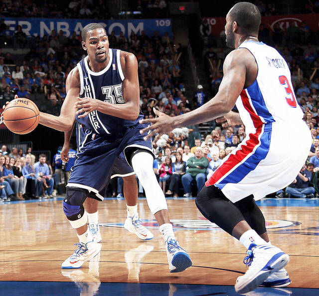 Oklahoma City�s Kevin Durant, left, passes around Detroit�s Rodney Stuckey earlier this season.  Photo by Nate Billings, The Oklahoman