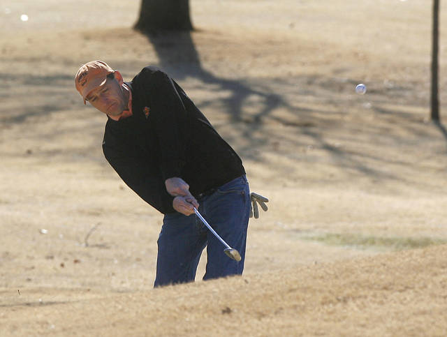 Robert LaFave chips a shot toward the green during the 11th Annual KickingBird two-man Iron Man Golf Tournament at KickingBird Golf Club in Edmond, OK, Saturday, Jan. 31, 2009. BY PAUL HELLSTERN, THE OKLAHOMAN