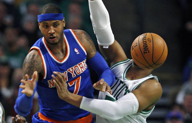 The basketball moves in front of Boston Celtics forward Jared Sullinger (7) on New York Knicks forward Carmelo Anthony's pass during the second quarter of an NBA basketball game in Boston, Thursday, Jan. 24, 2013. (AP Photo/Charles Krupa)